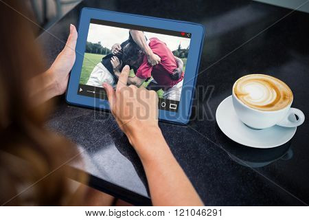 View of lecture app against woman having coffee and using her tablet