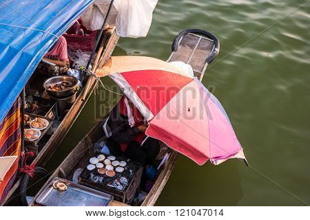 Trader's boats in a floating market in Thailand.