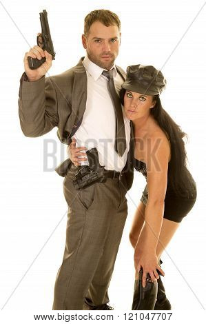 A woman bending down for her pistol with her arm around her man's waist.