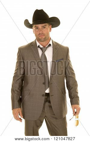 A cowboy in his suit and tie with his western hat on.