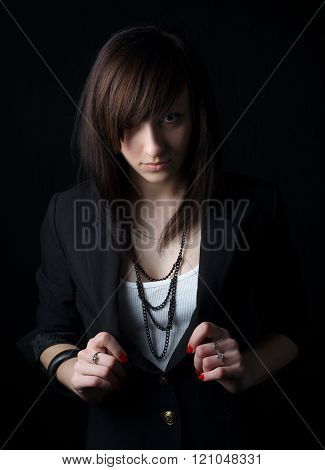 beautiful serious girl on dark background