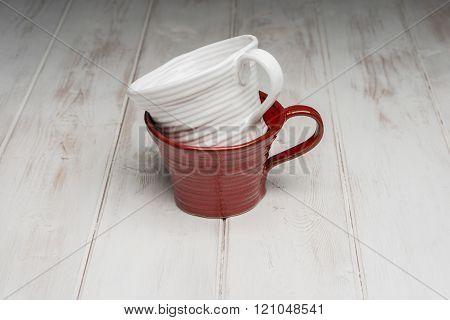White Tea Cup On A Red Tea Cup