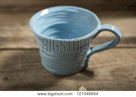 Blue Teacup On A Wooden Surface