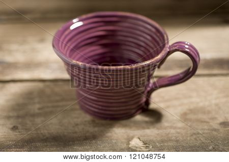 Brown Teacup On A Wooden Surface