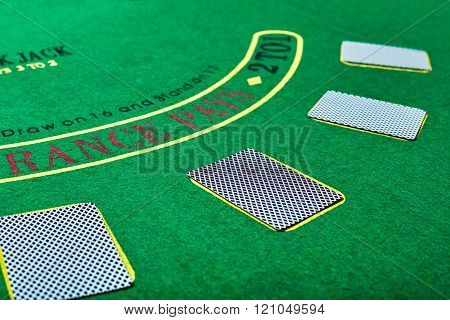 Playing cards on green table surface. Casino, gambling, poker concept