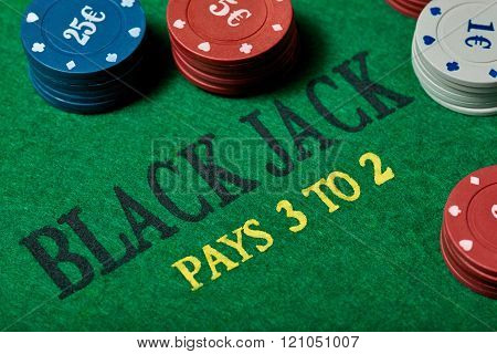 Black Jack gambling table with casino chips. Close-up