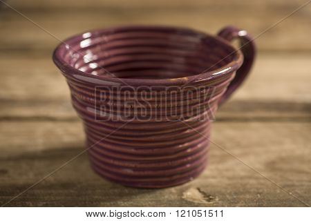 Close Up Of Brown Teacup On A Wooden Surface