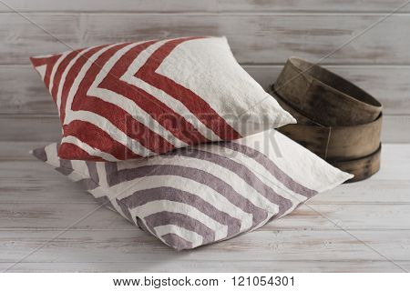 Stack Of Two Throw Pillows With Chevron Design