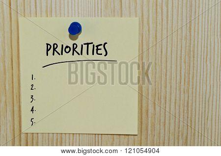 Priorities word on paper note