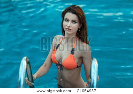 Woman In A Swimsuit Standing The Pool.