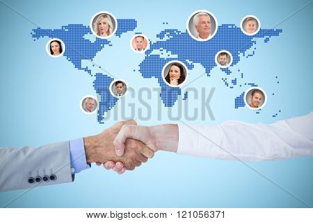 Business people shaking hands on white background against blue background