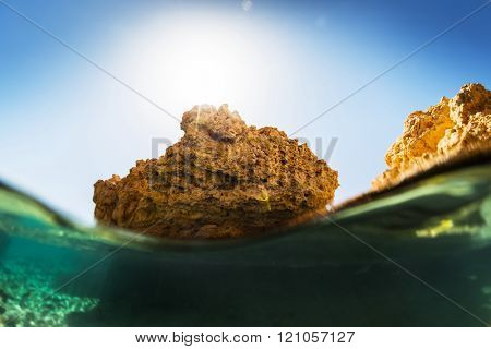 Split shot with the rocky land of the Ras Muhammad National Park, Red Sea, Egypt