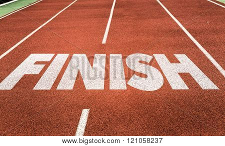 Finish written on running track
