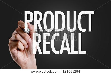 Hand writing the text: Product Recall