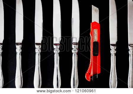 Utility knife in a raw with table-knives