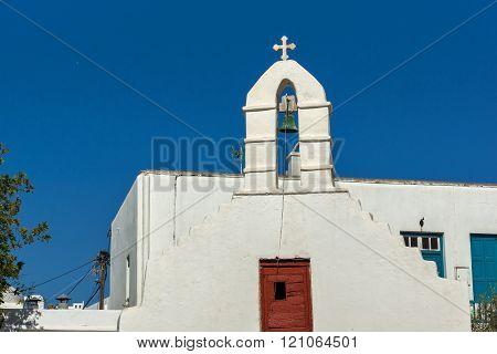 White orthodox church and belfry in Mykonos, Greece