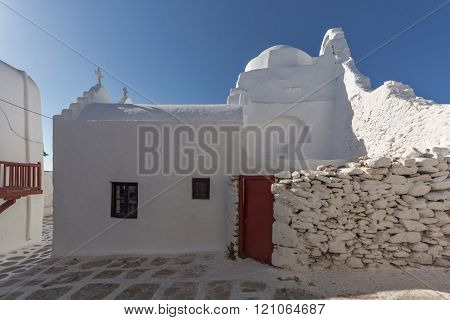 White orthodox church and houses in Mykonos, Greece