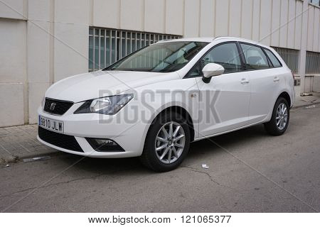 VALENCIA, SPAIN - MARCH 9, 2016: A White 2015 SEAT Ibiza Five-Door Hatchback Vehicle parked in the streets of Valencia. The SEAT Ibiza is a supermini car made by the Spanish automaker SEAT since 1984.