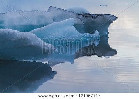 Detail image of luminous Blue, white and black Icebergs Floating In Jökulsárlón Glacial Lagoon, Iceland