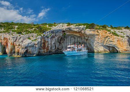 ZAKYNTHOS ISLAND, GREECE - JUNE 2015: Tourist boat in Blue Caves