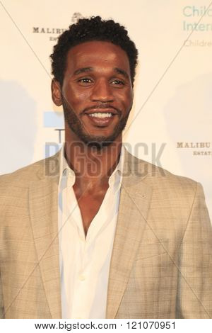 LOS ANGELES - MAR 5:  Kareem Rush at the Children International Charity's Share The Love Around The World Fundraiser at the Rocky Oaks Malibu on March 5, 2016 in Malibu, CA