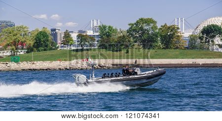Toronto, Ontario, Canada, Aug. 15, 2015, police patrolling and going at high speed on motor boat in the lake Ontario, Canada