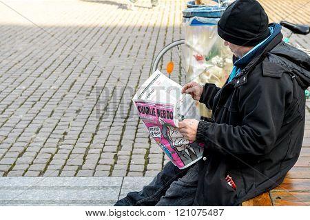 Man Reading Charlie Hebdo Magazine