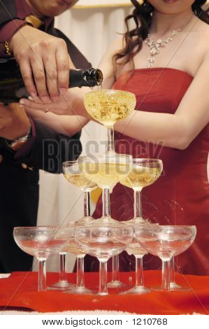 Newlywed pouring champagne