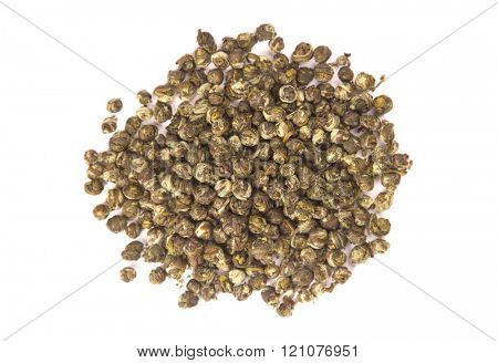Top view of Oolong leaves rolled into balls, isolated on white background