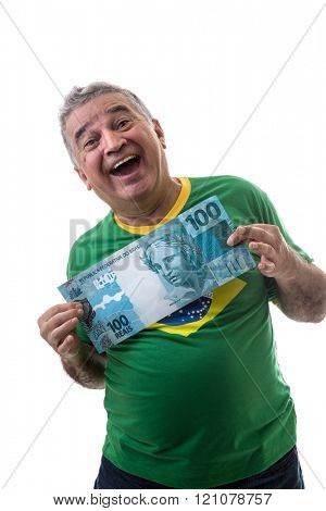 Happy Brazilian man showing reais (Brazilian money) on white background