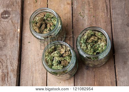 Marijuana Buds In Glass Jars