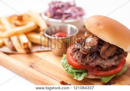 Beef Burger With Mushrooms And Onions And French Fries