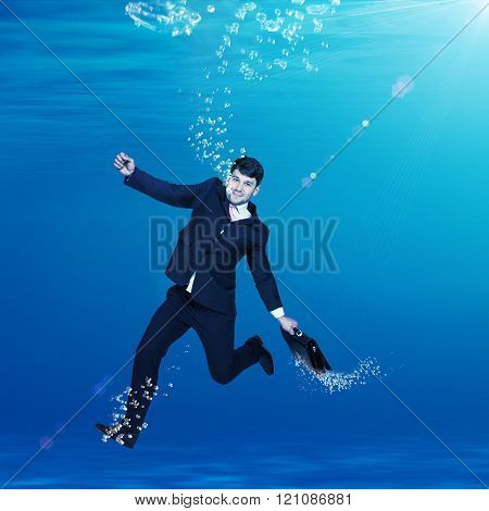 Businessman sinking in water