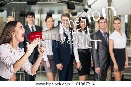 Business woman scream to megaphone