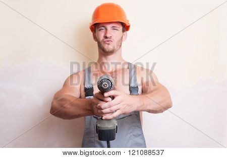 Man Worker With A Screwdriver