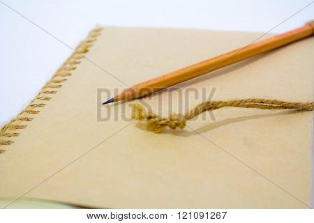 Close Up Of A Pencil And A Notebook