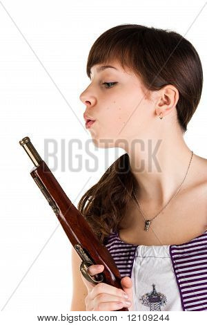 Beautiful Girl Blowing On A Gun