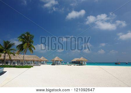 Beautiful beach with bungalow jetty at Maldives