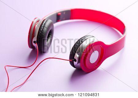 red headphones on violet background