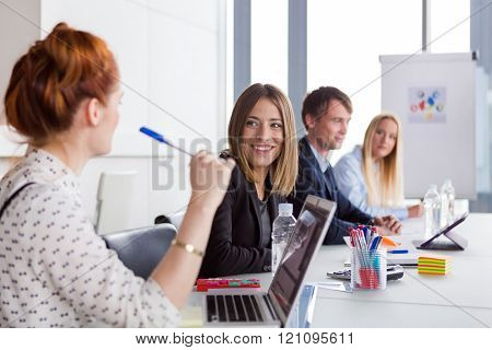 Business women discussing project during the meeting in modern office.