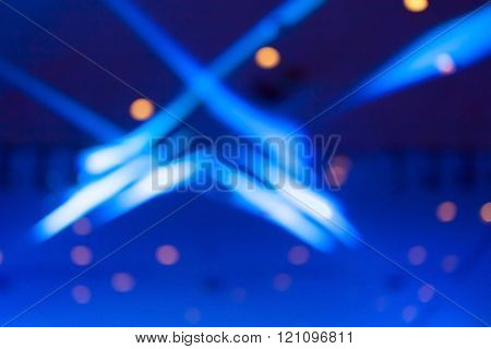Abstract Blurred Photo Of Blue Color Stage Lights.