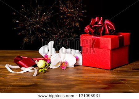 Greeting Red Box With Bow And Orchid Flower, Phalaenopsis On Wooden, Festive Firework Background, Cl