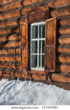 Window of a wooden house in the village