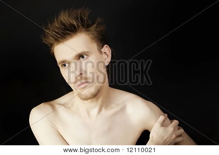 Young Serious Man With Blue Eyes And A Stylish Hairstyle