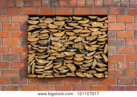 Firewood in the opening window