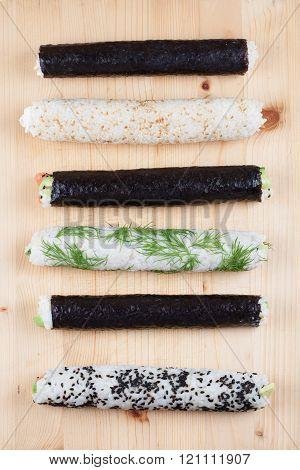 Homemade Sushi Rolls On Cutting Board
