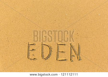 Eden - word drawn on the sand beach.
