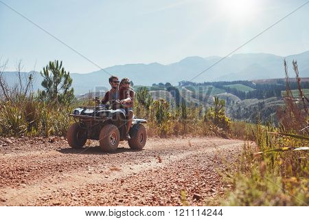 Couple On Holiday Enjoying On A Atv Bike Ride.