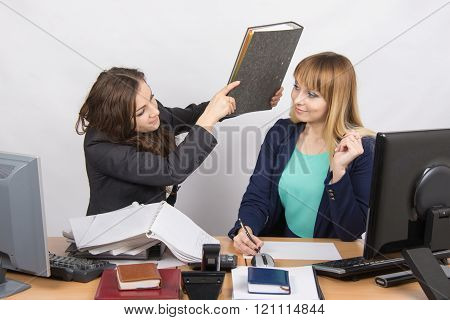 The Girl In The Office Of A Colleague That Threatens To Hit Its Folder