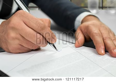 Notary's hands doing daytime paperwork.